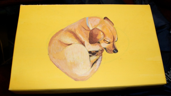A shoebox that I painted yellow and then painted Nelson's adorable little self onto it.